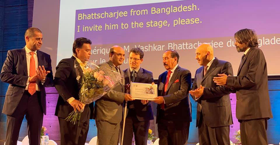 Vashkar of YPSA from Bangladesh receiving UNESCO award