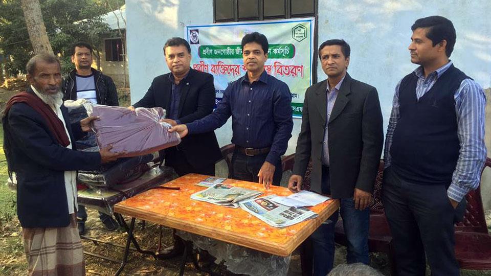 YPSA is distributing warm blankets to elderly person in Sitakund 2
