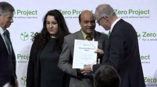 Vashkar receiving the award.