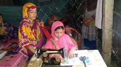A beneficiaries of YPSA receiving tailoring training from trainers