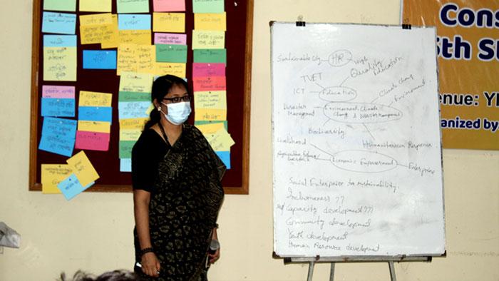Nasim Banu writing on white board